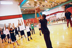 Students receive pointers in basketball during a previous NativeVision Sports and Life Skills Camp.