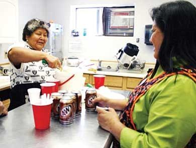 Shungapovi community ladies serve up root beer floats. <i>Submitted photo</i>