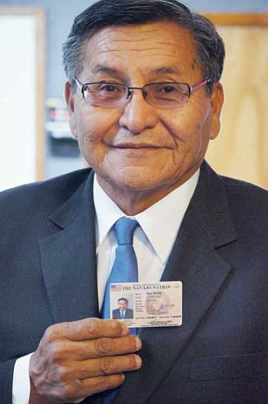 Navajo Nation President Ben Shelly proudly displays his identification card.