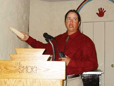 "Michael ""Kotutwa"" Johnson of Kykotsmovi Village at Hopi has completed his written and oral exams at University of Arizona to formally start his final doctoral work in American Indian studies with an emphasis on natural resource policy and law this fall. Johnson is shown at one of his numerous requested guest lectures he has conducted on organic Hopi dry-farm methods. <i>Rosanda Suetopka Thayer</i>"