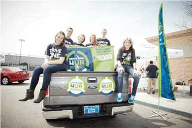 Page High School students lend a hand during a Drive One 4 UR School held in April. <i>Submitted photo</i>