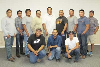 The newest graduates of the NGS Power Plant Fundamentals School are (front row left to right) Greg Bazan, Omar-Luis Moreno, Antonio Smith, (back row left to right) Shane Tsosie, Sean Clark, Jack Eltsosie, Wilson Laughter, Joshua Begay, Joseph Claw, Pepper Morgan and Myron Deel. Also pictured is NGS Metal Fabricator Adrian Yellowman. Photo/Regina Lane