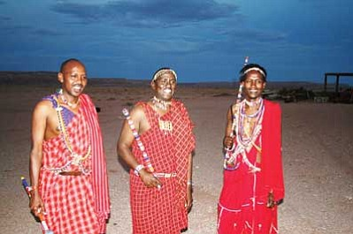 Left to right: Joshua Kiringal, Micheal Tiampati, John Kamanga. Project coordinator, South Rift Association of Land Owners of Nairbi, Kenya share stories and culture with local Navajo people. Gary Elthie