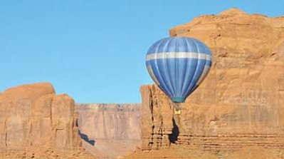 A pilot carefully guides his hot air balloon at Monument Valley Navajo Tribal Park. Photo/Roberta John