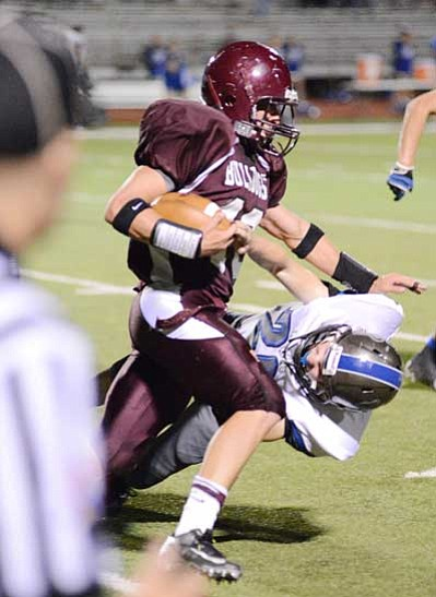 The Winslow Bulldogs fight hard against the Snowflake Lobos Sept. 28 in Winslow. <i>Todd Roth/NHO</i>