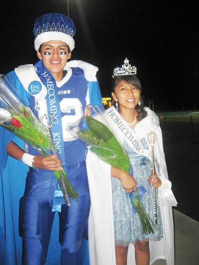 Homecoming King Allan Joshevama and Homecoming Queen Kenesha beam after being crowned. Stan Bindell/NHO
