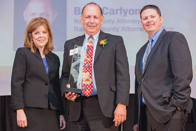 Navajo County Attorney Brad Carlyon Receives the Leader of the Year in Public Policy for Public Safety award from Arizona Capital Times Publisher Ginger Lamb and Editor Jim Small. Submitted photo
