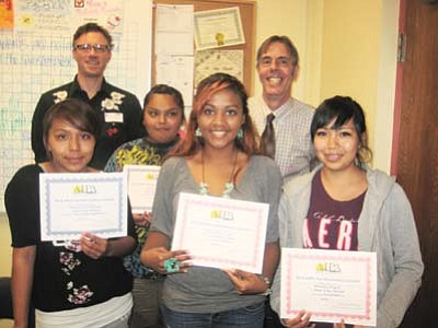 "Hopi High broadcast radio students show off their state awards. Pictured from left: Otivia ""Big Oh"" Puhuhefvaya, Janine ""Rabbit"" Shula, Christina Rucker and Shacely Miguel. Back row: KUYI Station Manager Richard Davis and Hopi High Principal Glenn Gilman celebrate with the studnts. Submitted photo"
