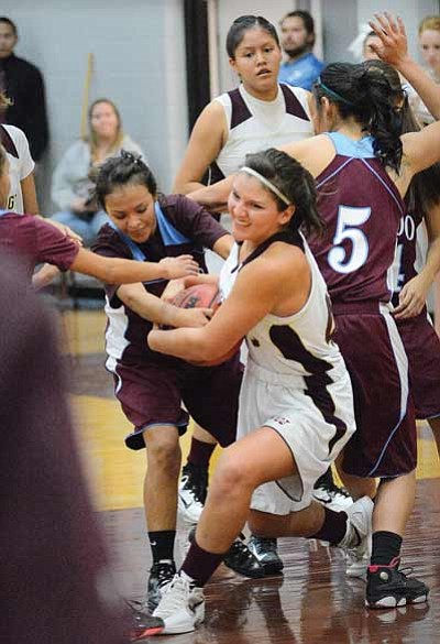 Shandiin Armao fights for the ball on the way to the Winslow Bulldogs' 58-30 win against Ganado Nov. 20. Photo/Todd Roth
