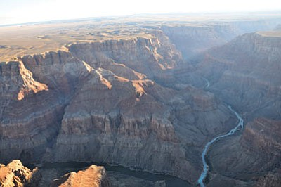Navajo and Hopi leaders have been meeting with federal officials in hopes of reviving a deal to settle tribal claims to water rights from the Little Colorado River, the milky river shown here at its confluence with the Colorado River. Photo/National Park Service
