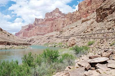 An artist's rendering of the proposed tramway from the rim of the Grand Canyon to the elevated walkway along the bank at the confluence of the Colorado and Little Colorado rivers as part of a proposed tourism development there. Photo/Confluence Partners LLC