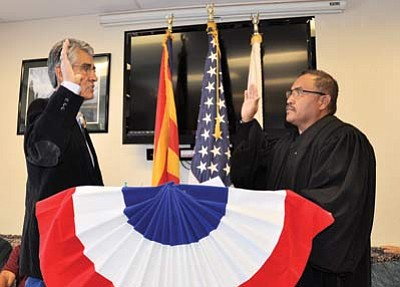 Chinle District Court Judge Victor Clyde swears in former Navajo President Joe Shirley, Jr. as Apache County Supervisor Dec. 4 in Chinle, Ariz. Photo/George Hardeen