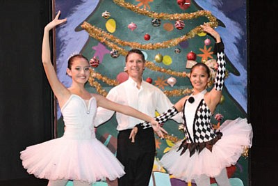Isabella Shey-Robbins (left) and Neida Rodriguez (right) pose with Andrew Needhammer, NAU Music and Dance Academy's dance program coordinator. Submitted photo