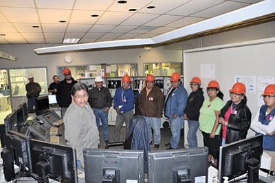 Operations Specialist Eddie Kent explains information on one of the many monitors used to run the Navajo Generating Station (NGS). Shonto Chapter officials and staff toured the plant Nov. 28 to learn about its operation, pollution controls, Navajo employment, history and importance in the Western Power Grid. From left to right are NGS Chemical Supervisor Rob Peterson, Control Room Supervisor Travis Francisco, Alden Miller, Paul Begay, UMWA Kayenta Mine Chairman Hank Whitethorne, Daniel Billy, Shonto Chapter Manager Robert Black, Wynn Bronston, Arlinda Mailboy, Shonto President-elect Elizabeth Whitethorne-Benally and Althea James.  Photo/George Hardeen