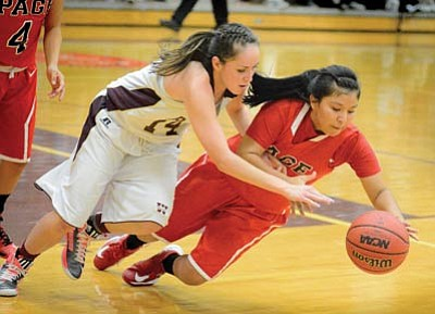 Marcella Joe goes for a steal during the Lady Bulldogs' commanding 47-30 win over Page Dec. 18. Photo/Todd Roth