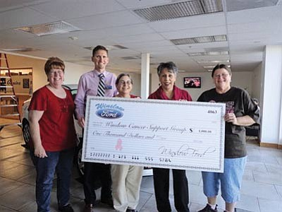 Winslow Ford's Seth Gaston presents a $1,000 check to members of the Winslow Cancer Support Group. Pictured from left: Ann Egan, Petra Velez, Seth Gaston, Bert Cole and Ginger Dickson. Submitted photo