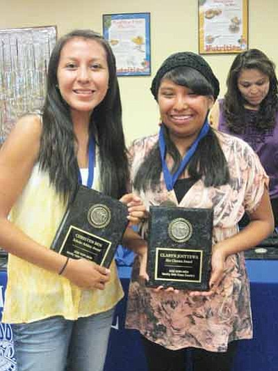 """Christen Ben (left) and Claryn """"Mighty Mouse"""" Josytewa have had a great school year. In November, they were part of the Hopi High girls cross country state championship team and recently qualified for the Wings of America team, earning a trip to compete in St. Louis, Mo. Stan Bindell/NHO"""