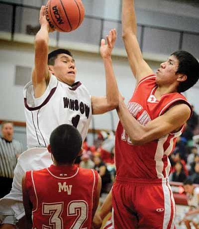Michael Goldtooth drives to the basket. Photo/Todd Roth