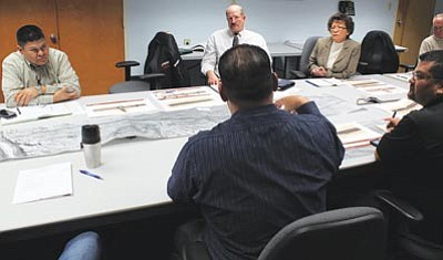 Navajo Division of Transportation Director Paulson Chaco listens to a presentation from David Benton, Arizona Department of Transportation (ADOT)project manager. ADOT is proposing an Intergovernmental Agreement with the Navajo Nation for a new $35 million road project in Cameron. Photo/Rick Abasta