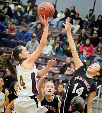 Winslow's Halle Hayes shoots over Coconino's Marissa Copley. Photo/Todd Roth