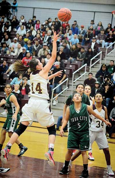 Winslow's Marcella Joe slashes to the hoop against Tuba City Jan, 31. Tuba City prevailed 50-49. Todd Roth/NHO