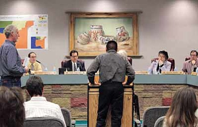 Navajo Division of Transportation Director Paulson Chaco reports to the San Juan County Commission about the Memorandum of <br /><br /><!-- 1upcrlf2 -->Understanding between the Navajo Nation and the county. Standing to the left of Chaco is Dave Keck, San Juan County Public Works administrator. Photo/Rick Abasta