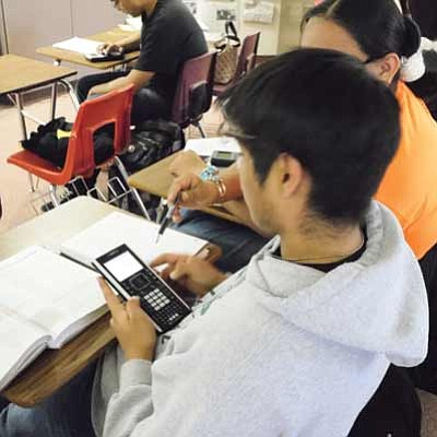 Tuba City High School calculus students use Texas Instruments graphing calculators to do their assigned math work. Rosanda Suetopka Thayer/NHO