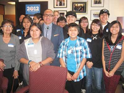 Arizona State Sen. Jack Jackson Jr. poses with students from Hopi Jr./Sr. High School after meeting with the group prior to the 18th annual Indian Nations and Tribes Legislative Day Feb. 5. Jackson and Hopi Chairman LeRoy Shingoitewa want Arizona lawmakers to adopt a cabinet position for a Native American. Stan Bindell/NHO