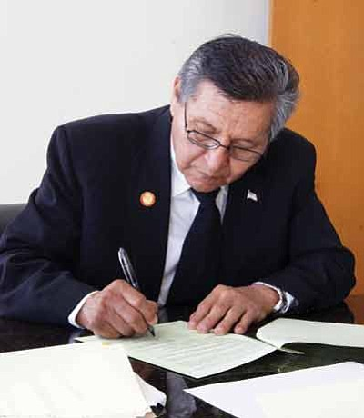Navajo Nation President Ben Shelly signs a loan agreement for $2.8 million to pay for the emergency response effort to fix freezing pipes on the reservation. Submitted photo