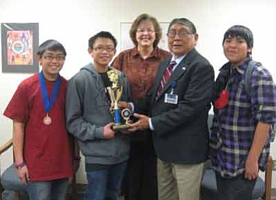Hopi Junior High Principal Albert Sinquah (second from right) congratulates the spelling bee team. Pictured from left: Sean Bolus, Nicholai Bolus, Advisor Rita Keith, Sinquah and Antonio Puhuyesva. Photo/Stan Bindell