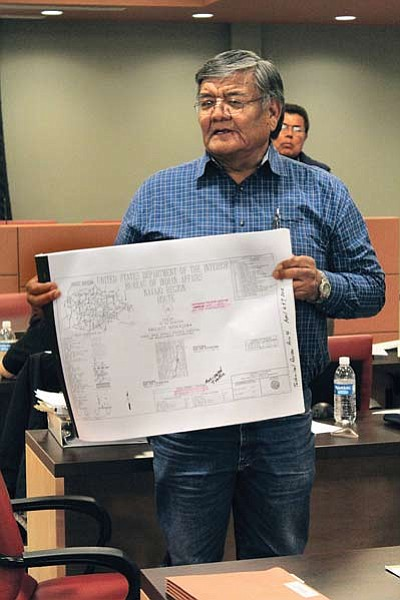 Floyd Stevens, Coppermine Chapter president, holds a N20 paving feasibility study by Western Pacific during a March 7 meeting. Photo/Rick Abasta