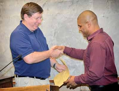 Winslow Mayor Robin Boyd (left) presents a Proclamation of Appreciation to Lady Bulldogs basketball coach Jerron Jordon for winning the State Championship in Division  III Basketball. Photo/Todd Roth