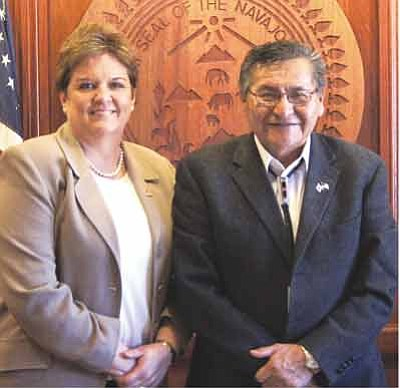 Navajo Nation President Ben Shelly (rights) stands with FEMA Region 9 Administrator Nancy Ward before signing a tribal agreement allowing FEMA to help with costs relating to frozen water pipes on the Navajo Reservation. Submitted photo