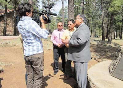 A reporter with French CNN interviews from left  Hopi Tribal Councilmen Mervin Voyetewa, Art Batala and Hopi Chairman LeRoy Shingoitewa at the Museum of Northern Arizona April 7. A French auction house plans to auction around 70 Hopi  sacred objects April 12. Katherine Locke/WGCN
