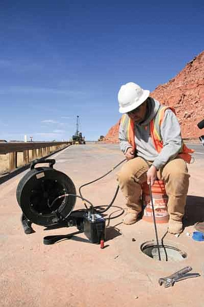 An ADOT crew member conducts geotechnical work on U.S. 89. Photo/ADOT