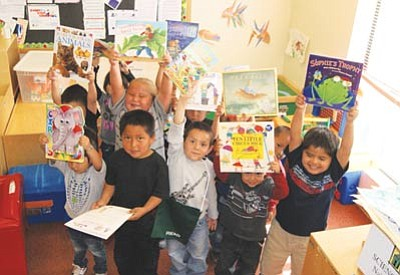 Children at a Navajo Head Start enjoy new books the Navajo Library donated April 16. Submitted photos