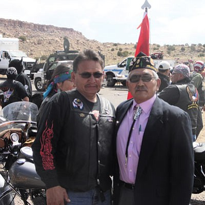 A Navajo Hopi Honor Rider stands with former Hopi Vice Chairman Phillip Quochytewa (right) who is also an officer with Hopi Lori Piestewa Post No. 80 chapter at the Hopi Tribal Court complex. Photo/Rosanda Suetopka Thayer