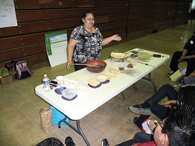 Clara Dallas speaks Hopi as she teaches the names of Hopi food and ingredients at a recent workshop. Photo/Kristin Harned