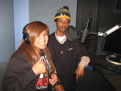 Sacheen Mike gets pointers from Jahlil Jackson at Youth Radio in Oakland, Calif. Photo/Stan Bindell