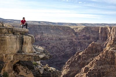 Nik Wallenda looks at the area over the Little Colorado River in the Grand Canyon. Wallenda will tightrope walk over the canyon June 23. Photo/Jason Elias/Discovery Channel.