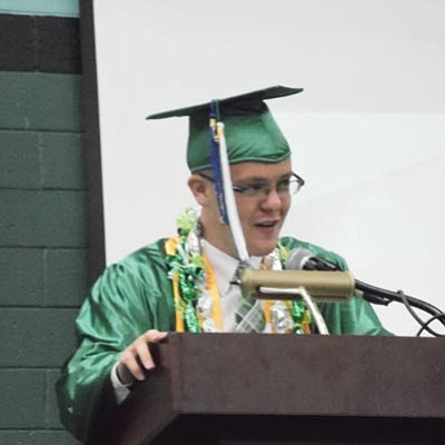 Class of 2013 Valedictorian Ryan Moran gives his commencement address to the capacity crowd at the Warrior Pavilion May 25. Photo/Rosanda Suetopka Thayer