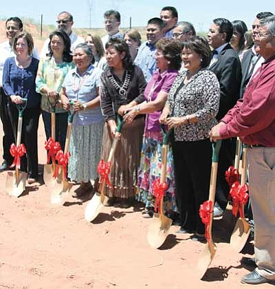 Representatives from the Navajo Nation, Arizona Department of Transportation, Federal Highway Administration, Bureau of Indian Affairs, Coconino County, and local chapter officials smiled after breaking ground for Navajo Route 20. After months of planning and negotiations, construction of the roadway is officially underway. Photo/Rick Abasta