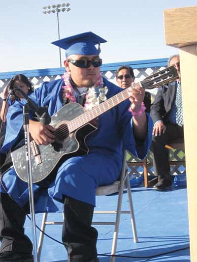 Xavier Simone Sakeva started the graduation off on the right foot with a classical guitar solo.