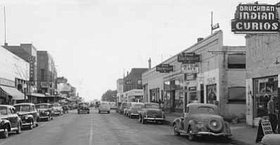 U.S. Route 66 in downtown Winslow as seen looking east in the 1940s. Photo/Old Trails Museum/Winslow Historical Society