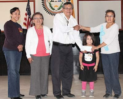 Navajo Nation President Ben Shely gives a $9,800 check From the Federal Emergency Management Agency to members of the Casamero Lake Chapter. Submitted photo