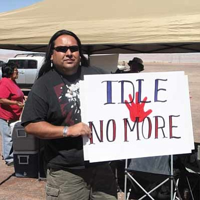 Milton Tso, Cameron Chapter president, protests against the Nik Wallenda high wire walk June 23 at the junction of Highway 89 and High way 64 near the walk site. Photo/Rosanda Suetopka Thayer