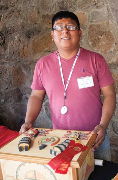 Ryan Gashweseoma stands with an award winning Kachina box at the Hopi Festival of Art and Culture July 7 at the Museum of Northern Arizona. Ryan Williams/NHO