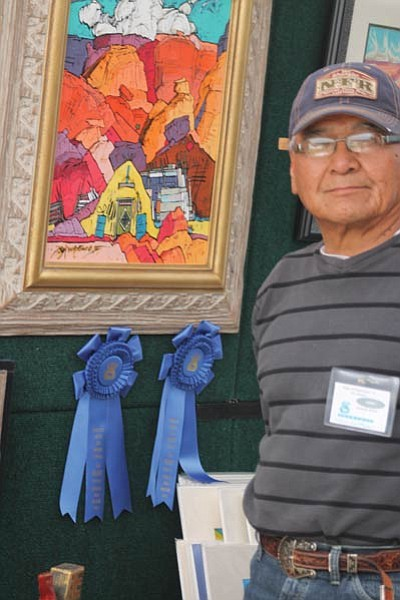 Baje Whitethorne Sr. with his award winning painting. Photo/Stan Bindell