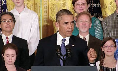 President Barack Obama, backed by several dozen people he said have benefited from health care reform, made a renewed case for the law as the House voted to delay key parts of it. Photo/White House