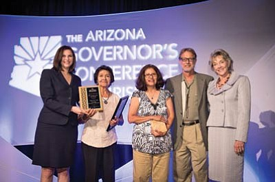 From left: Britan O'Brien, director of Southern Region Office of Governor, Frances Quotskuyva, Darlene Banks, Mike Finney, and Sherry Henry celebrate the Hopi Arts Trail's Governor's Tourism award win July 11. Submitted photo
